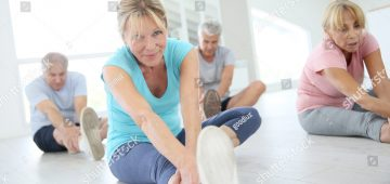 stock-photo-group-of-senior-people-doing-stretching-exercises-319145279