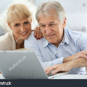 stock-photo-senior-couple-websurfing-on-internet-with-laptop-207102778